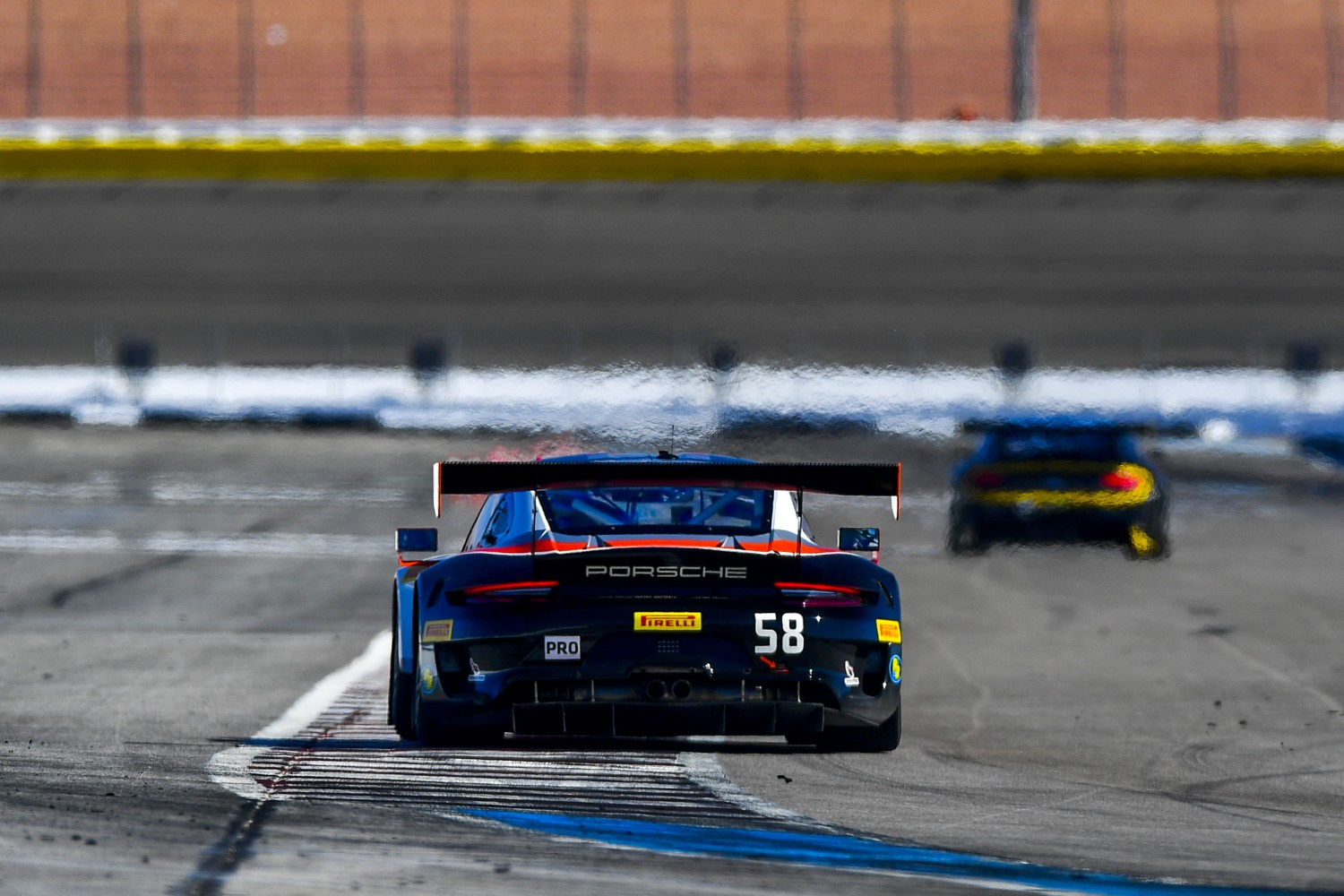 #58 Porsche 911 GT3 R (991) of Patrick Long and Scott Hargrove with Wright Motorsports  2019 Blancpain GT World Challenge America - Las Vegas, Las Vegas NV | Gavin Baker/SRO